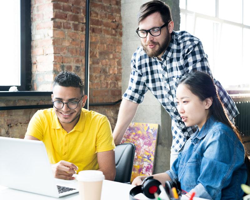 creative-business-team-using-computer-in-office-3GWRXTU.jpg